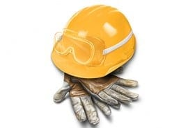 hard hat with safety goggles and work gloves.